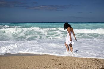 Women Wearing White Dress on the Sea during Daytime