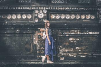 Women's Blue Sleeveless Shirt Near Gray Concrete Wall