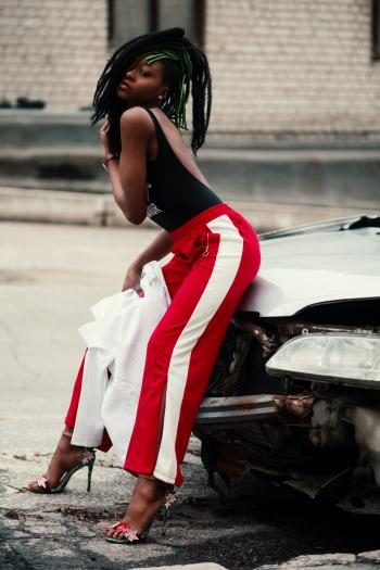 Women's Wearing Black Backless Top With Red and White Pants