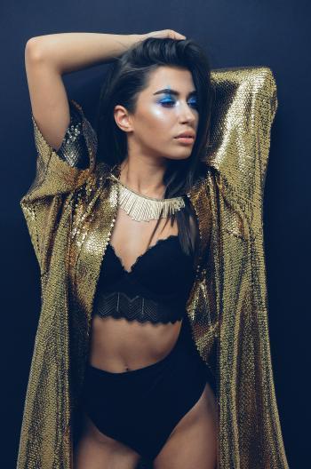 Women's Wearing Gold Sequin Cardigan