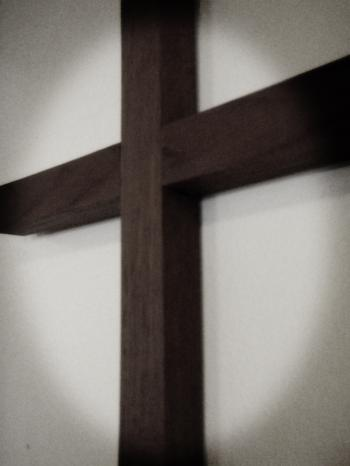 Wooden cross on the wall