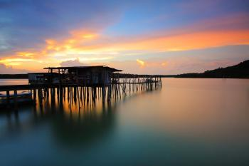 Wooden House in Body of Water during Sunset Photo