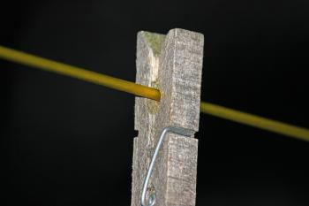 Wooden peg on a washing line