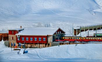 Yellow and Red Train Beside Snowy Mountain