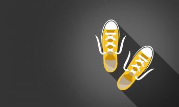 Yellow Sneakers on Dark Background - With Copyspace