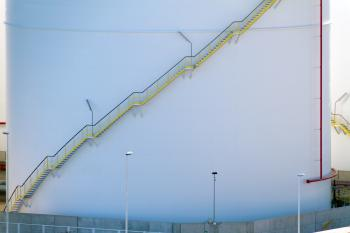 Yellow stairs on a white storage tank