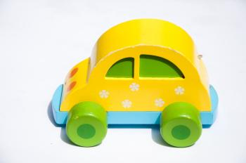 Yellow wooden toy car