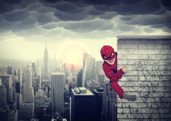 Young boy dreams of being a superhero
