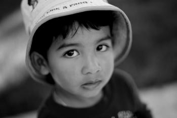 Young boy with a hat - b&w