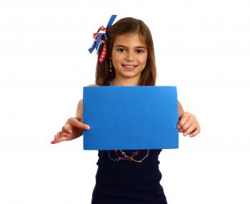 Young girl holding a blank blue sign