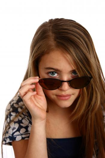 Young girl posing with sunglasses