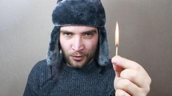 Young man holding a match