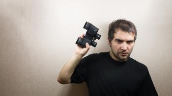 young man with binoculars