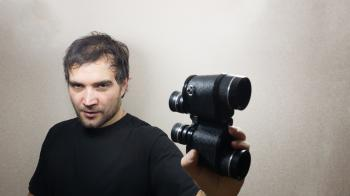 young man with binoculars