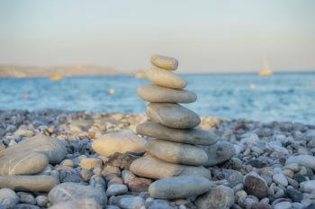 Zen-like pyramid of stone on the beach