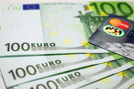 100 Euro Bills Beside Mastercard