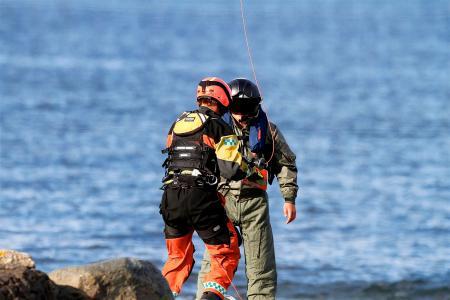 2 Person Wearing Jumpsuit Near Body of Water