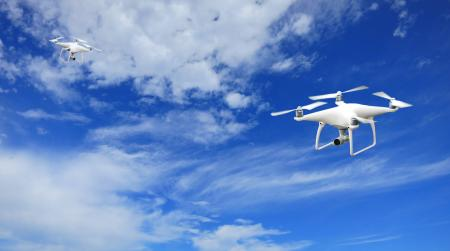 2 Quadcopter Under Blue Sky and White Clouds