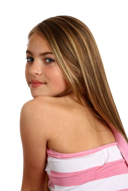 A beautiful young girl posing on white