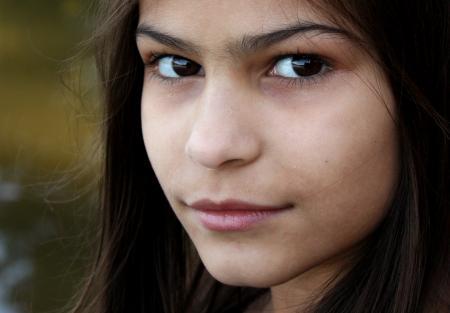 A beautiful young girl posing outdoors