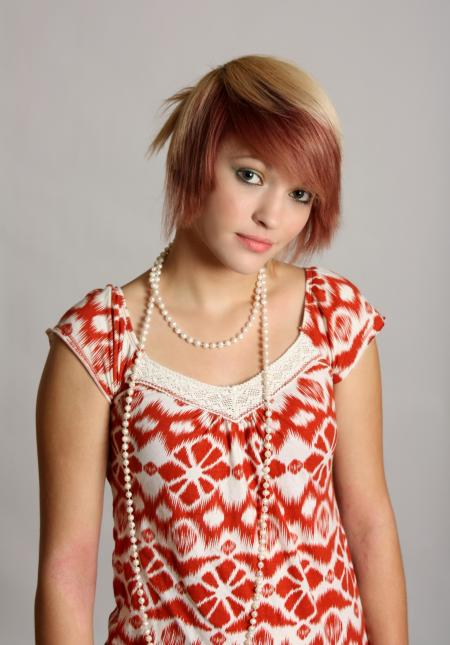 A beautiful young woman wearing pearls