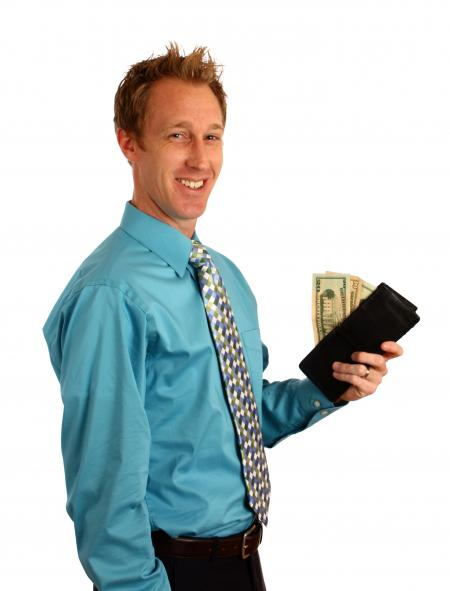 A businessman holding a wallet