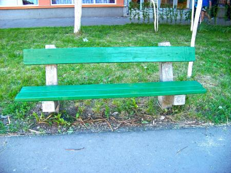 A green bench in a park
