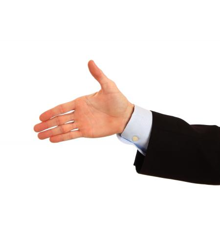 A hand being held out for a handshake