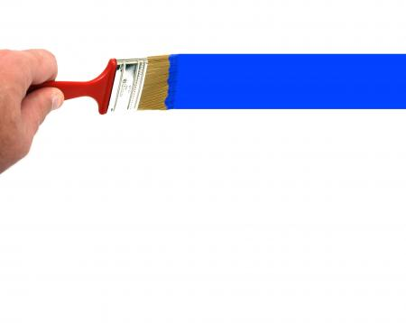 A hand painting a blue line with a paint