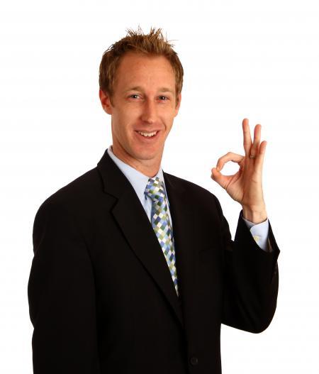 A young businessman giving an ok signal