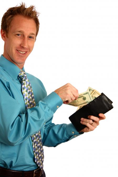 A young businessman holding a wallet