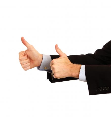 A young businessman making a thumbs up g
