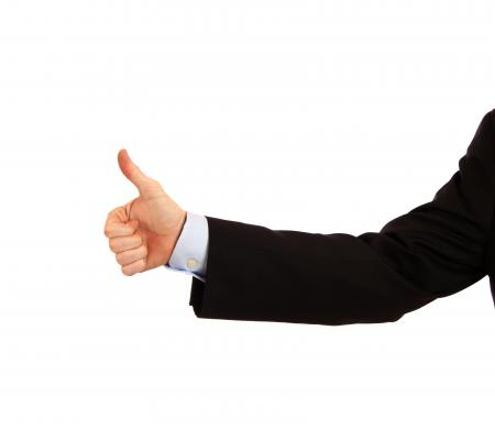 A young businessman making a thumbs up