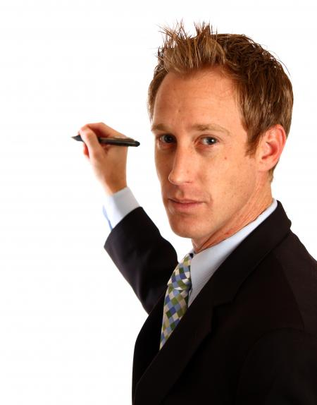 A young businessman writing with a pen