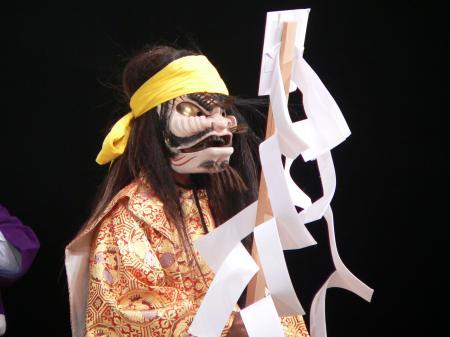 Actor wearing a traditional Japanese Kagura mask