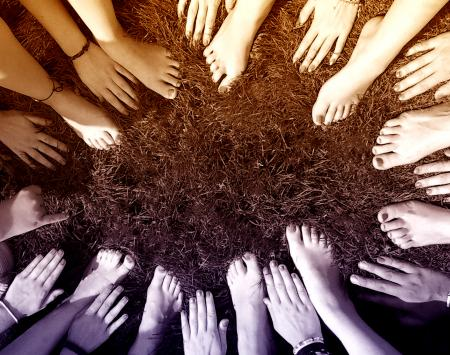 All Together - People Joining Hands and Feet in a Circle