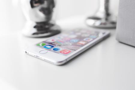 Apple iPhone 6 Plus on a white desk