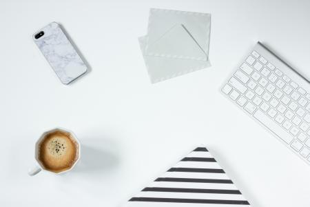 Apple Magic Keyboard Besides White Letter Envelope