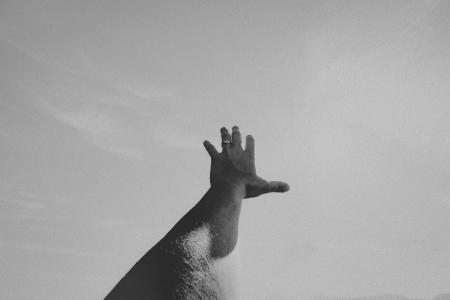 arm stretched out to the sky