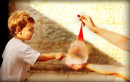 Baby Boy Popping A Balloon