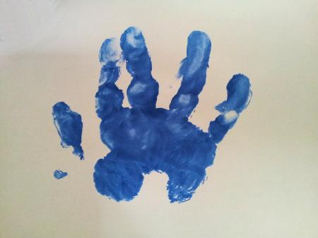 Baby hand inprint over white surface