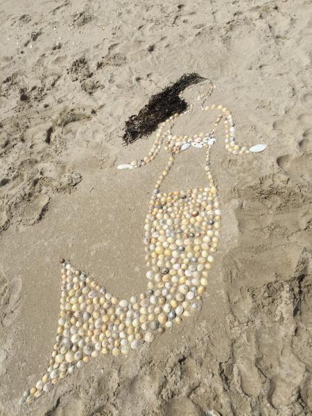 Beige Sea Clams Mermaid Figure on Seashore