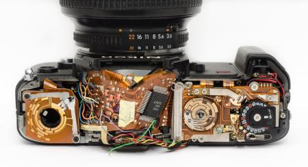 Black Dslr Camera Showing Its Circuit Board