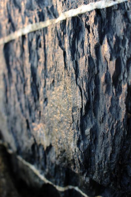 Black rock texture with white veins