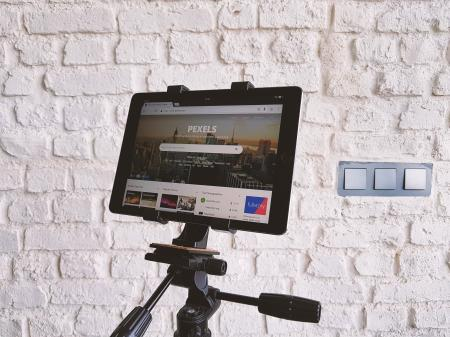 Black Tablet Computer Showing Pexels Webpage