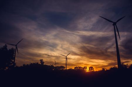 Black Windmills during Sunset