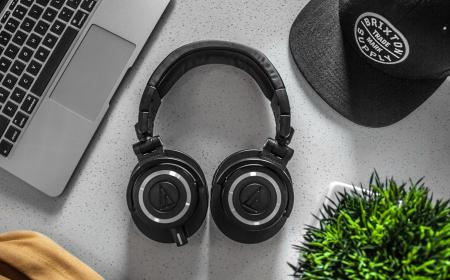Black Wireless Headphones On White Table