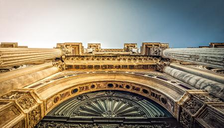 Bottom View of Vintage Arch during Daytime
