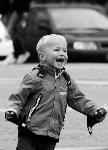 Boy Wearing Jacket on Street in Grayscale Photography