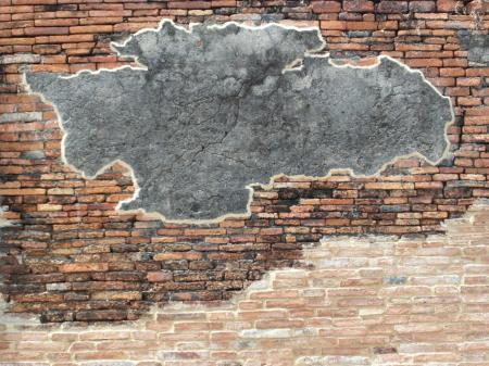 Brick Wall with Blank Concrete Patch